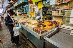 Jerusalem, Israel- August 16, 2016: A Jewish man and boy shopping in a Jerusalem, Israel market stock photo