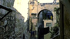 Jerusalem Church of the Holy Sepulchre. Jerusalem, Israel - Circa 1979: old Church of the Holy Sepulchre in ancient streets of the Muristan Christian Quarter stock footage