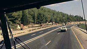 Highway to Jerusalem. JERUSALEM, ISRAEL - CIRCA 1981:Vintage footage, point of view of a tourist bus driving on the highway to Jerusalem city on 80s, Israel stock video footage