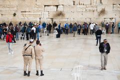 JERUSALEM, ISRAEL - December 1, 2018: Israeli soldiers and ,pPeople praying at the Western Wall stock photo