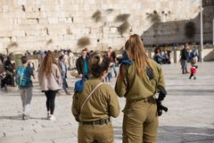 JERUSALEM, ISRAEL - December 1, 2018: Israeli armed women soldiers and at the Western Wall royalty free stock photography