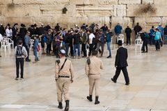 JERUSALEM, ISRAEL - December 1, 2018: Israeli soldiers and ,pPeople praying at the Western Wall stock image