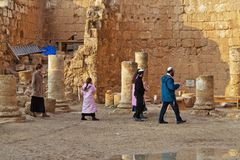 The Jewish family is considering of Herodium Herodion Fortress. JERUSALEM, ISRAEL - DECEMBER 28, 2016: The Jewish family is considering of Herodium Herodion Stock Photos