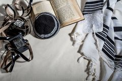 Talit, Kippah, Tefillin and Siddur, jewish ritual objects. JERUSALEM, ISRAEL - DECEMBER 21: Jewish ritual objects, prayer vestments, Talit, Kippah, Tefillin and Royalty Free Stock Image