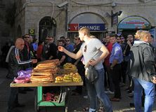 Man is selling bread outdoor in the old city of Jerusalem, Israel Royalty Free Stock Image