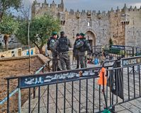 Police officers are on duty near Damascus Nachem Gate to old cit. JERUSALEM, ISRAEL - DECEMBER 29, 2016: Police officers are on duty near Damascus Nachem Gate to stock images