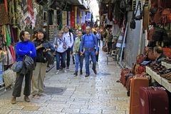 Tourists are walking by market in the old city Royalty Free Stock Photos