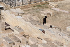 JERUSALEM, ISRAEL - 27 FEB 2017 - Jew praying at the Mount of Olives Jewish Cemetery Royalty Free Stock Images