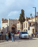 JERUSALEM, ISRAEL - FEBRUARY 15, 2013: Pedestrians and cars near Royalty Free Stock Images