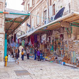 JERUSALEM, ISRAEL - FEBRUARY 16, 2013: Tourists buying souvenirs Royalty Free Stock Image