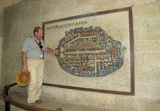 JERUSALEM, ISRAEL. The guide shows the ancient Byzantine mosaic map of ancient Jerusalem Royalty Free Stock Photography