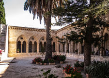 JERUSALEM, ISRAEL - JULY 13, 2015: The gothic corridor of atrium in Church of the Pater Noster on Mount of Olives. Israel Royalty Free Stock Photo