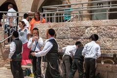 Religious jewish boys near to Western Wall in Jerusalem, Israel stock image