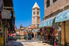 Small square and belfry in Old City of Jerusalem. Royalty Free Stock Photos