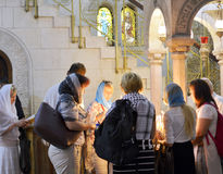 Jerusalem, Israel, 11 June 2017 Pilgrims Light Candles in the Sa. To the left of the main entrance of the sanctuary of the Church of the Holy Sepulchre Stock Photography