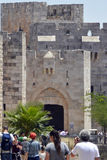 Jerusalem, Israel 11 June 2017 Tourists and Residents Approach t. Detail of the ramparts, crenelations and gate arches of the Jaffa Gate Entrance to the Old City Royalty Free Stock Photography