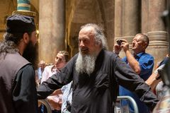 Undefined priests in Jerusalem`s Church of the Holy Sepulchre, site of the crucifixion, burial, and resurrection of Jesus Christ. JERUSALEM, ISRAEL -  - JUNE 22 stock photography