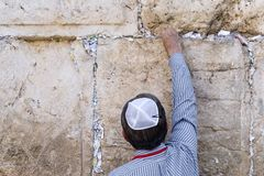 Jerusalem Israel, leave the letter with a prayer. Tourist puts a letter with a request to God in the gap in the stock photos