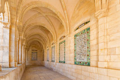 JERUSALEM, ISRAEL - MARCH 3, 2015: The gothic corridor of atrium in Church of the Pater Noster on Mount of Olives Stock Images
