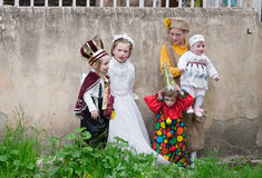 JERUSALEM, ISRAEL - MARCH 15, 2006: Purim carnival in the famous ultra-orthodox quarter of Jerusalem - Mea Shearim. Group portrait of five children dressed in Stock Image
