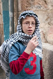 JERUSALEM, ISRAEL - MARCH 15, 2006: Purim carnival in the famous ultra-orthodox quarter of Jerusalem - Mea Shearim. Portrait of a boy children dressed in Stock Photo
