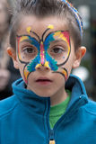 JERUSALEM, ISRAEL - MARCH 15, 2006:  Purim carnival, portrait of little boy on his face painted butterfly. Stock Images