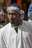 JERUSALEM, ISRAEL - MARCH 15, 2006: Purim carnival. Portrait of a man. On his head he tied round bandanna around his neck a necklace of shells Royalty Free Stock Images