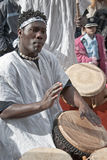 JERUSALEM, ISRAEL - MARCH 15, 2006: Purim carnival, street musician playing the tam-tam drums. Stock Images