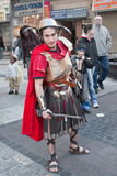 JERUSALEM, ISRAEL - MARCH 15, 2006: Purim carnival. A young man dressed in a suit of a Roman soldier with a sword in his hand. Purim is celebrated annually royalty free stock image