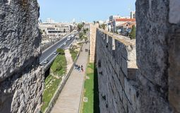 View from the city wall to Khativat Yerushalayim street passing near Jaffa Gate and the fortress walls city walls in old city of J. Jerusalem, Israel, March 09 stock image