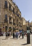 The tourists,locals and palmers on Christian Quarter coblestone. Jerusalem, Israel - May 11, 2018: The tourists,locals and palmers on Christian Quarter Royalty Free Stock Images