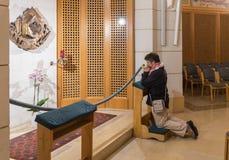 The believer kneels and prays in Church of Saint Peter in Gallicantu in Jerusalem, Israel. Jerusalem, Israel, November 17, 2018 : The believer kneels and prays stock image