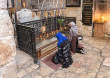 Believers kneel and pray in the lower hall in Alexander Nevsky church in Jerusalem, Israel. Jerusalem, Israel, November 17, 2018 : Believers kneel and pray in royalty free stock image