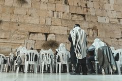 JERUSALEM, ISRAEL. 24 October 2018: People praying to their religion at the Wailing Wall or Kotel in historic old city. Of Jeruslam stock photography