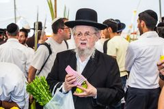 Orthodox Jew with white beard in black hat. JERUSALEM, ISRAEL - OKTOBER 8, 2014: Traditional market before the holiday of Sukkot. Orthodox Jew with a white beard Royalty Free Stock Image