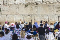 People pray a the Western Wall, Wailing Wall or Kotel the Place of Weeping is an ancient limestone. Jerusalem, Israel - 10/20/2017: People pray a the Western royalty free stock image