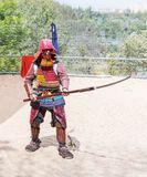 A festival participant in traditional samurai armor shows the art of naginata at the annual festival `Jerusalem Knights` stock photo