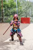 A festival participant in traditional samurai armor shows the art of naginata at the annual festival `Jerusalem Knights` royalty free stock image