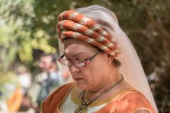 Medieval dressed middle aged woman at annual knights festival. JERUSALEM, ISRAEL - SEPTEMBER 22, 2017: medieval dressed middle aged woman at annual knights stock image