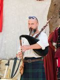 The musician plays on bagpipes at the festival `The Knights of Jerusalem` in Jerusalem, Israel. Stock Photography