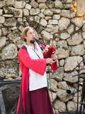 The musician plays on bagpipes at the festival `The Knights of Jerusalem` in Jerusalem, Israel. Stock Images