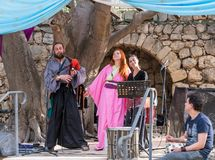 Musicians in authentic costumes play bagpipes and pipes for visitors at the annual festival `Jerusalem Knights`. Jerusalem, Israel, September 29, 2018 stock photography
