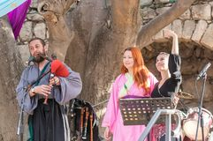 Musicians in authentic costumes play bagpipes and pipes for visitors at the annual festival `Jerusalem Knights`. Jerusalem, Israel, September 29, 2018 royalty free stock photography