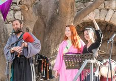Musicians in authentic costumes play the bagpipes for visitors at the annual festival `Jerusalem Knights`. Jerusalem, Israel, September 29, 2018 : Musicians in stock image