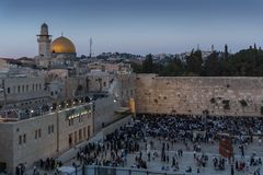 Numerous believers are in the evening near the Western Wall in the old city of Jerusalem for a holiday prayer dedicated to the hol royalty free stock photos