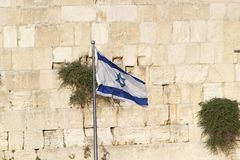 Jerusalem. Israeli flag is waving at the Western Wall in the Jerusalem old town, Jerusalem, Israel Stock Photos