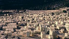 Jerusalem Jewish cemetery. Aerial view panorama of the ancient Jewish cemetery from Olive mountain. Old Jerusalem city on 80s, Israel. Historic restored footage stock video footage