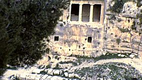 Jerusalem tombs of Benei Hezir and Zechariah. Jerusalem Kidron Valley with of the monumental rock-cut tombs of Benei Hezir and Zechariah. ancient Jewish cemetery stock footage