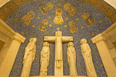 Jerusalem - The mosaic of Madonna and the Crucifixion sculptural group in side apse of Dormition abbey Royalty Free Stock Image