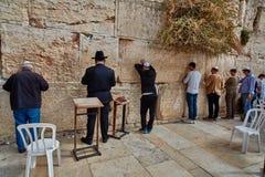 Jerusalem - 15 November, 2016: Men praying at the wailing wall Stock Photos